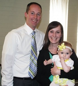 Kaleb and Lisa Phelps with their daughter
